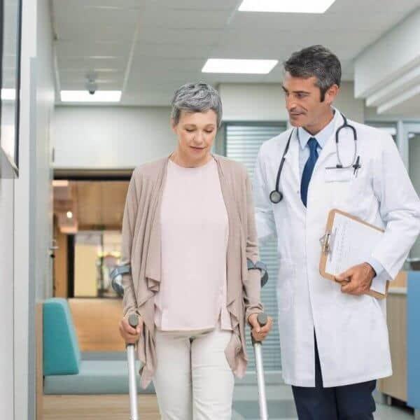woman_walking_with_crutches.jpeg
