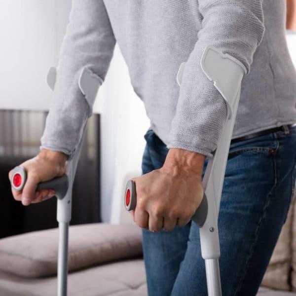 men_walking_with_crutches.jpeg
