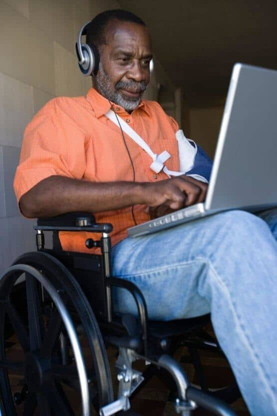 black_men_in_wheelchair_with_laptop.jpeg