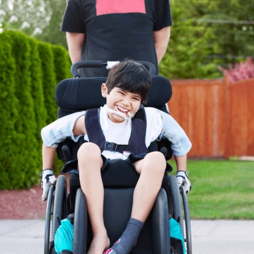 kid_riding_in_portable_wheelchair.png