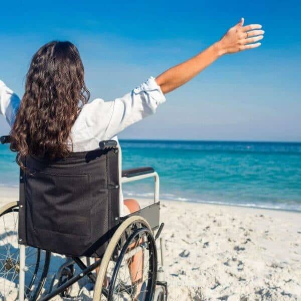 woman_in_wheelchair_near_sea.jpeg