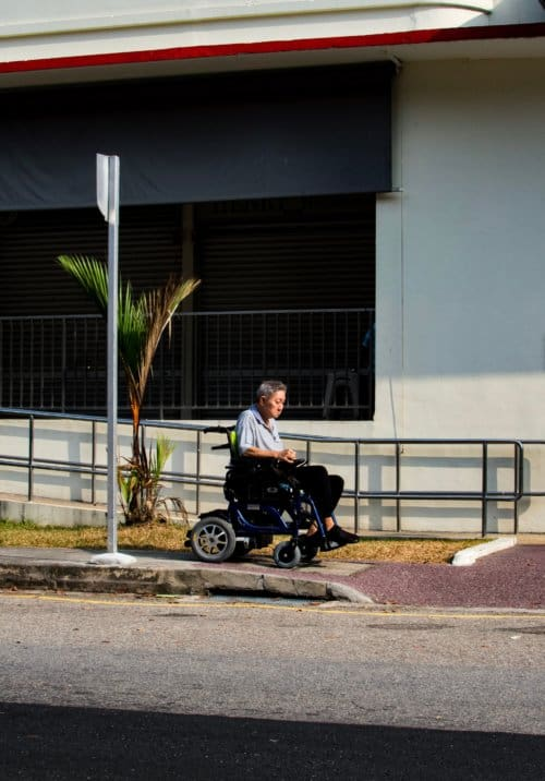 old_men_riding_in_electric_wheelchair.jpeg