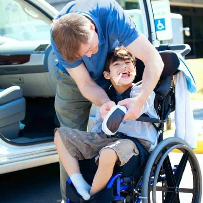 disabled_child_in_wheelchair_with_father.jpeg