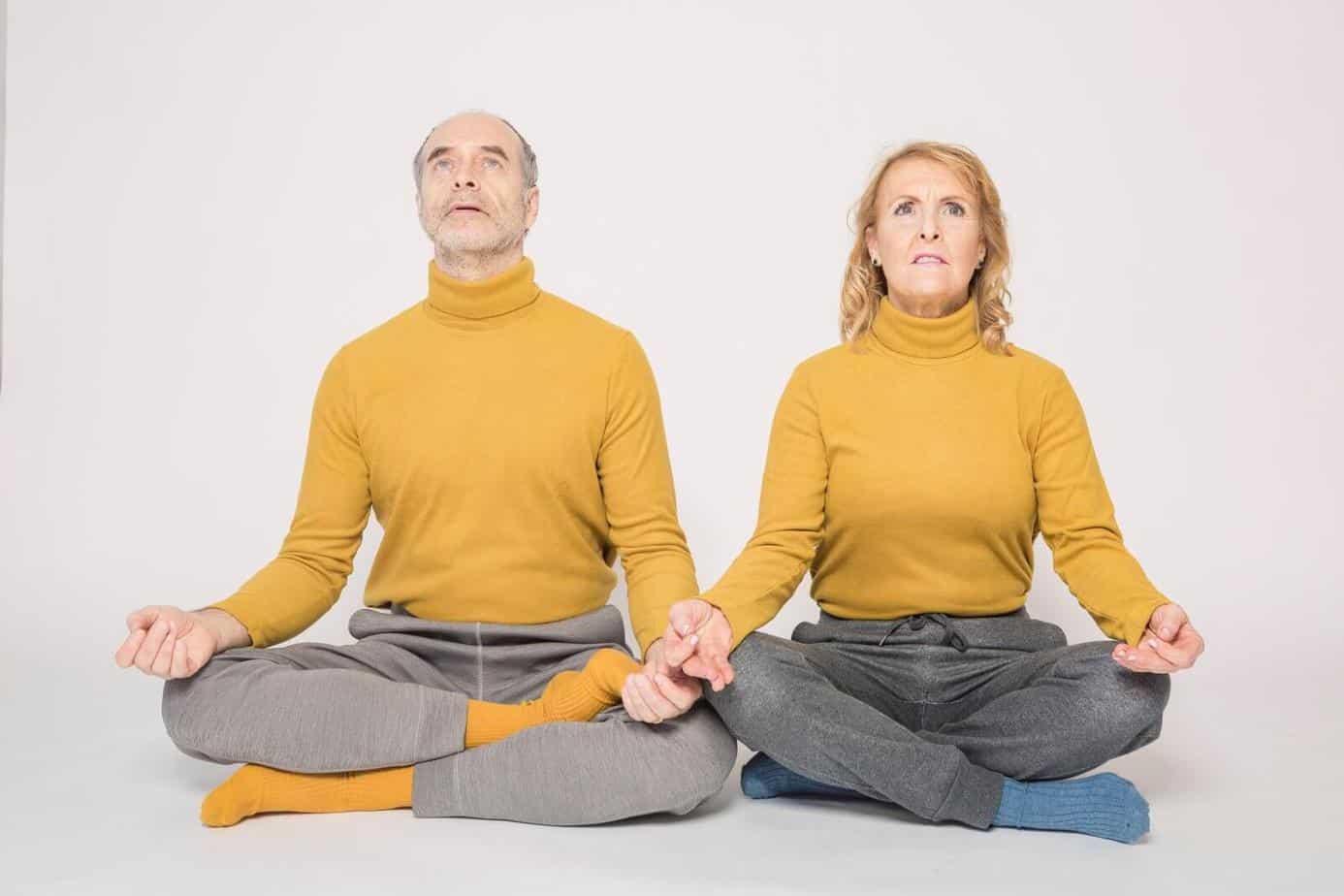 Elder man and woman doing Yoga