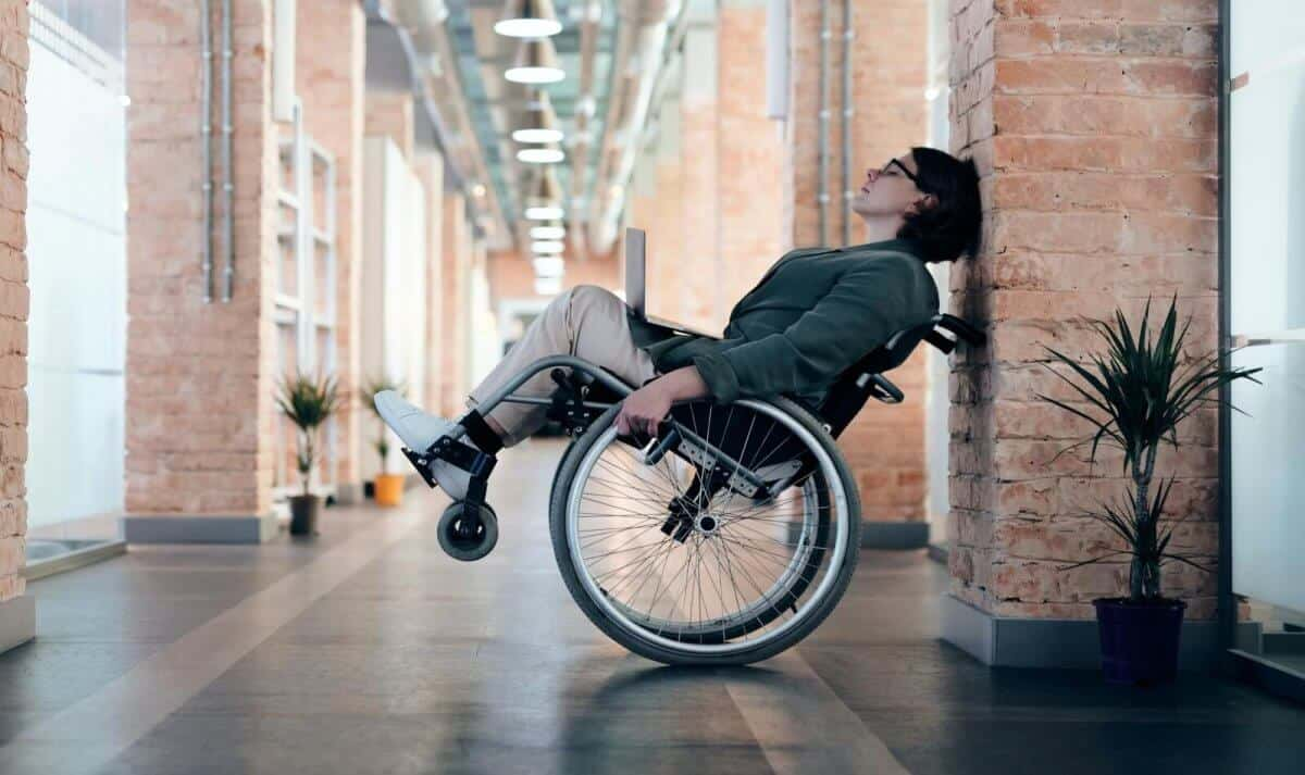 woman leaning back in wheelchair