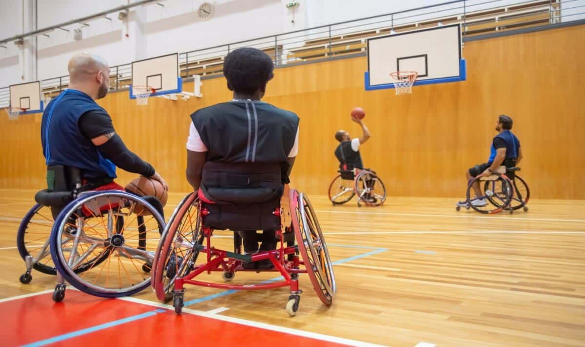 men playing wheelchair basketball at a basketball court