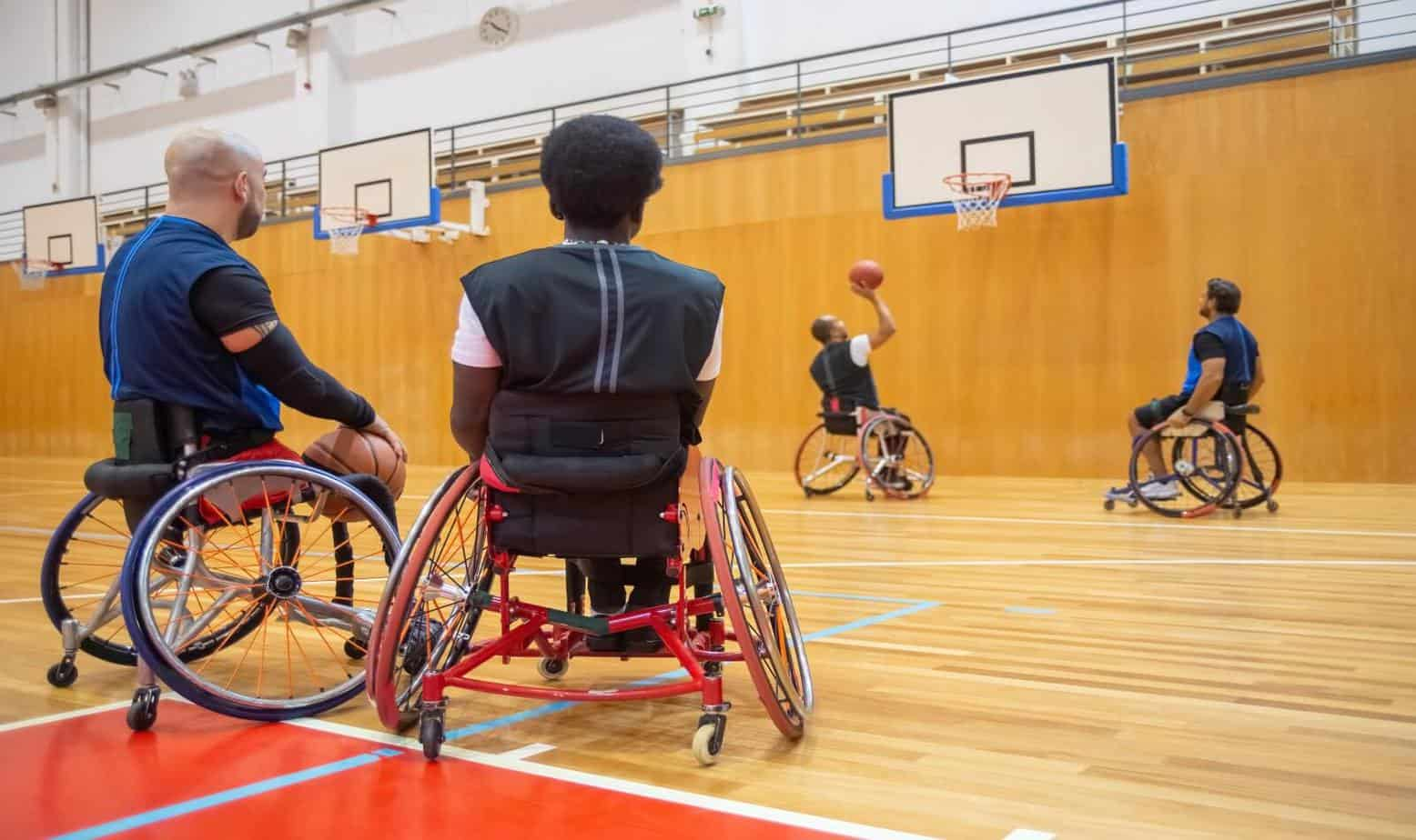 men playing wheelchair basketball at a basketball court