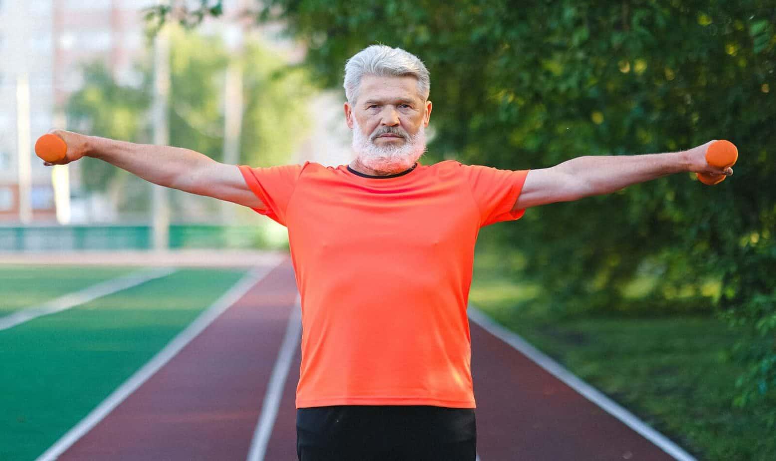 sporty elderly man performing shoulder exercise for seniors