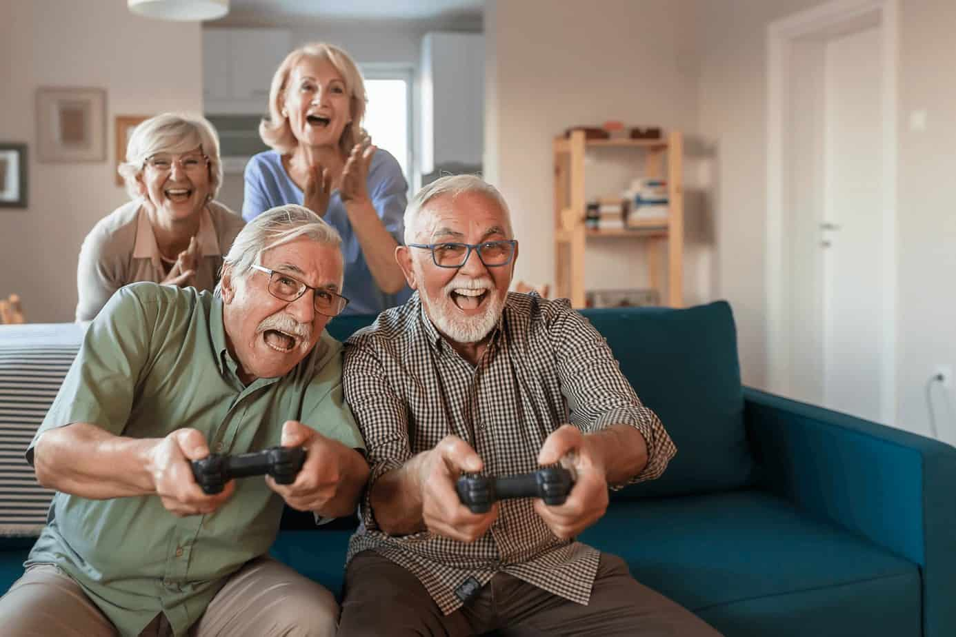 seniors playing play station in the celebrant's house, one of the best 75th birthday ideas