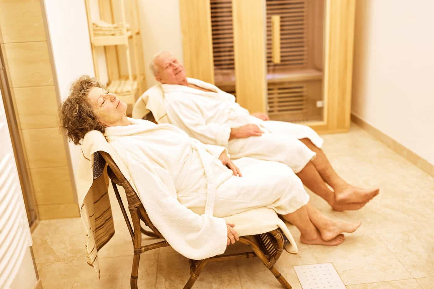 senior couple in their wardrobes having a spa day, great 75th birthday ideas