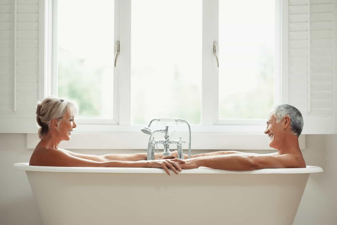 a senior couple in a bathtub