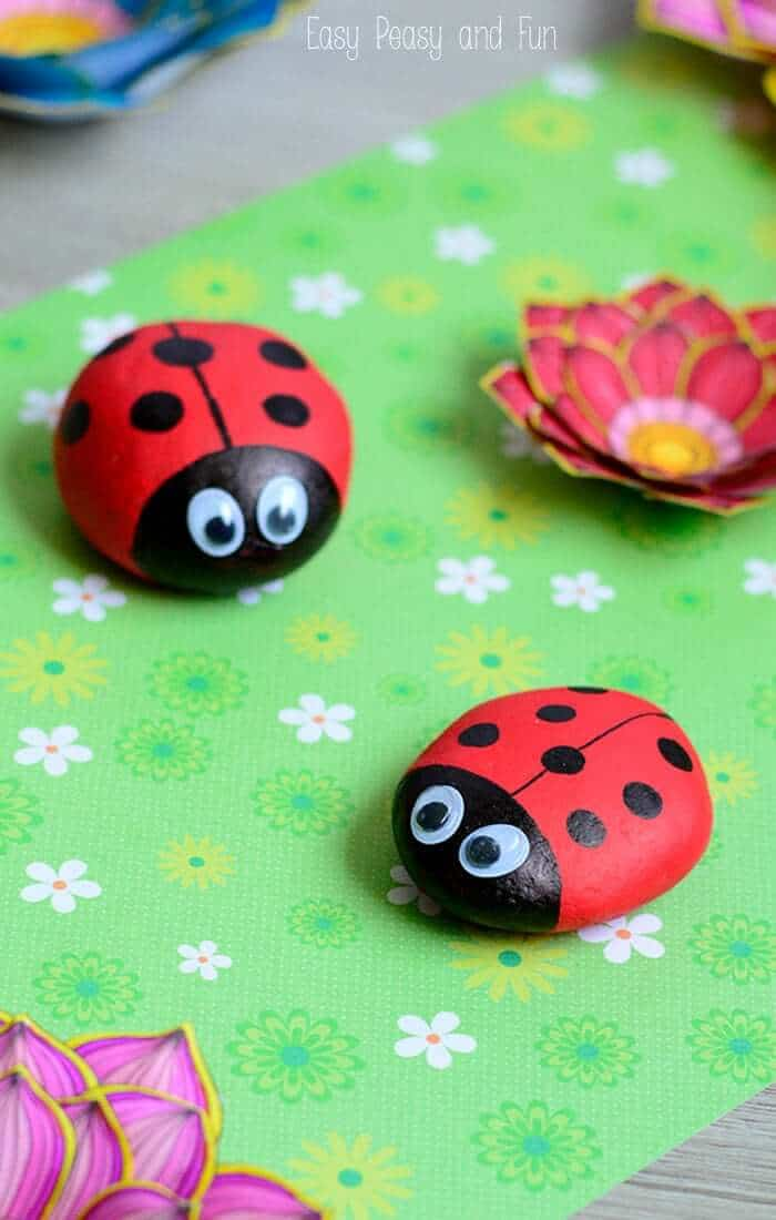 rocks painted as lady bugs