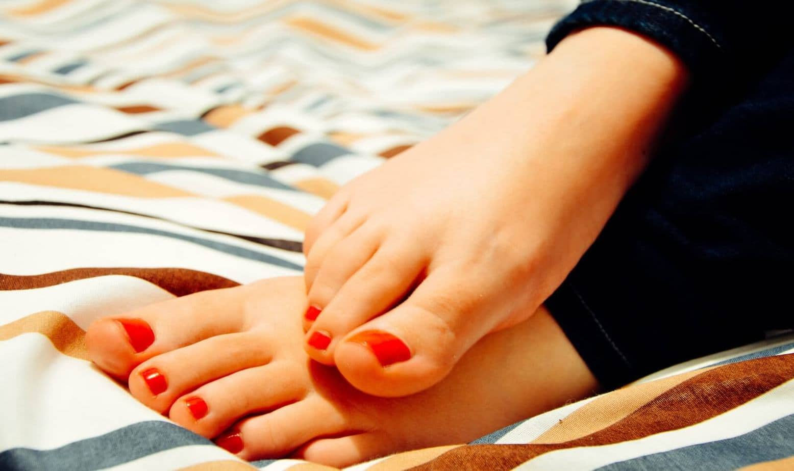 a flawless feet with red pedicure