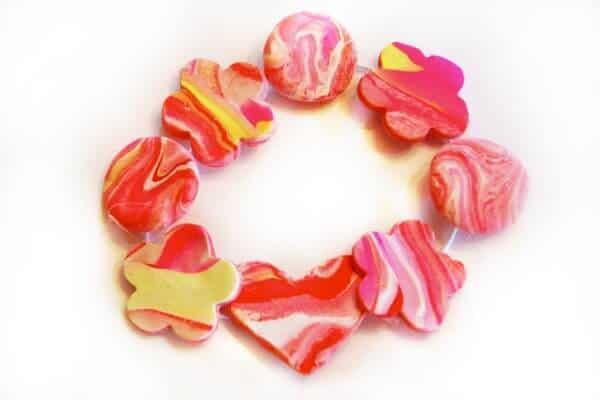 red bracelet made of marbles