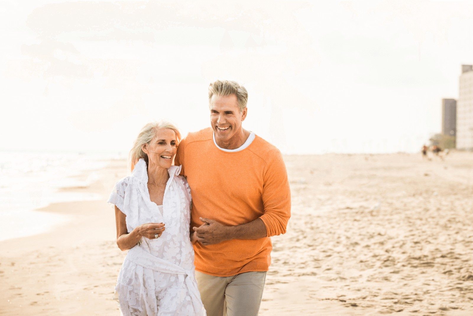 a senior couple walking down the beach, a sample of dating in your 60s