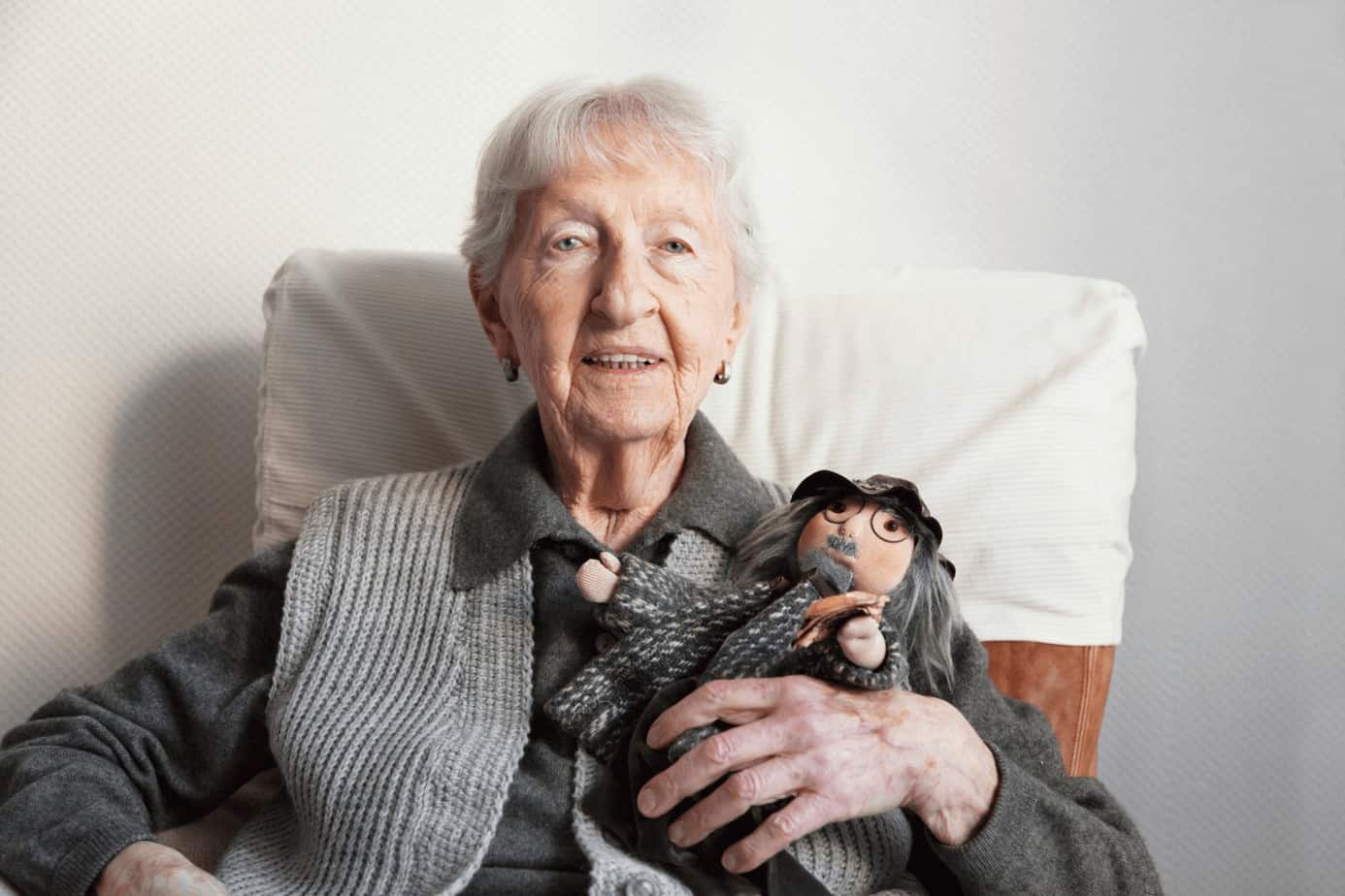 old woman holding a doll