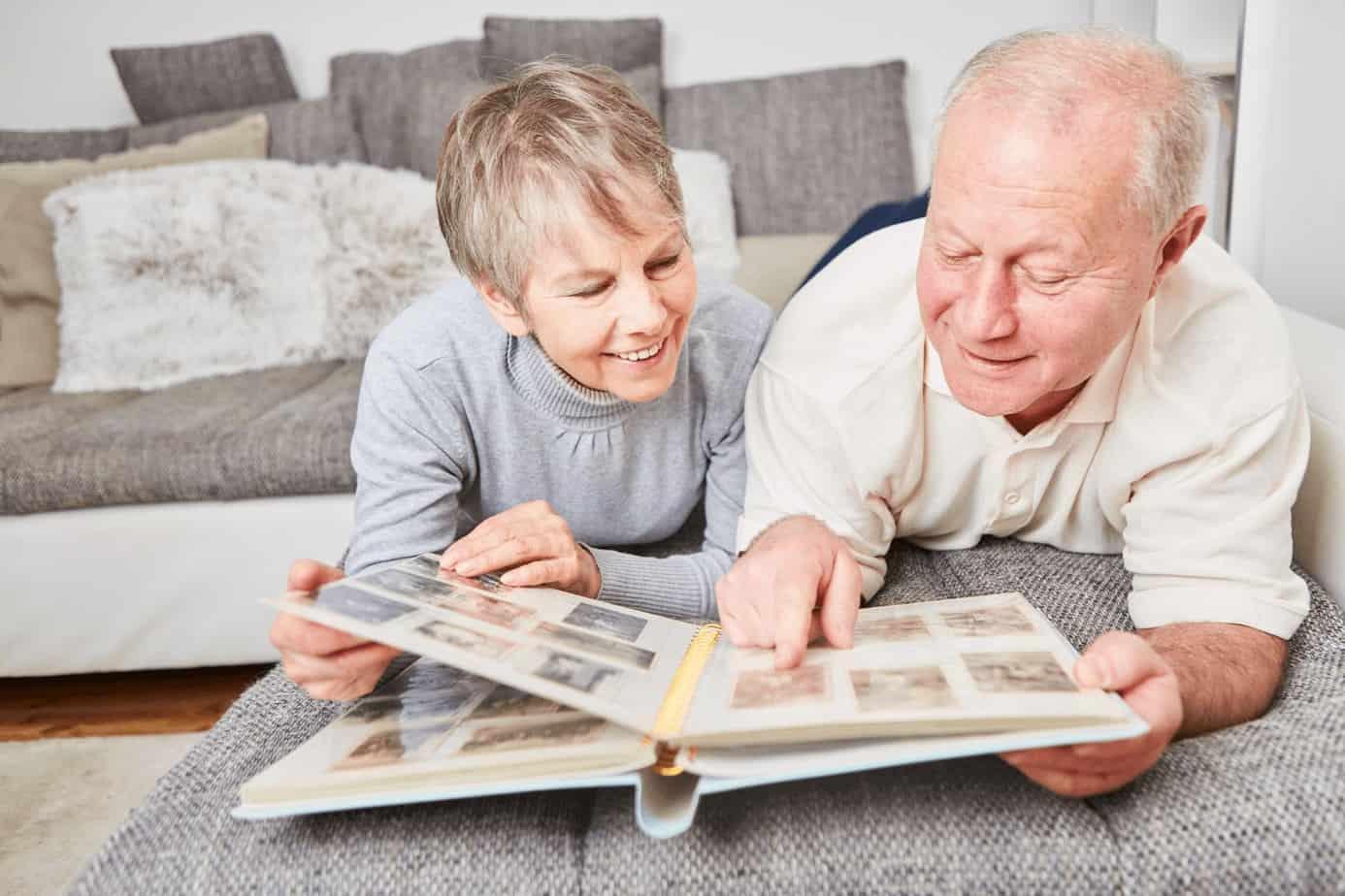 senior couple browsing through an old photo album