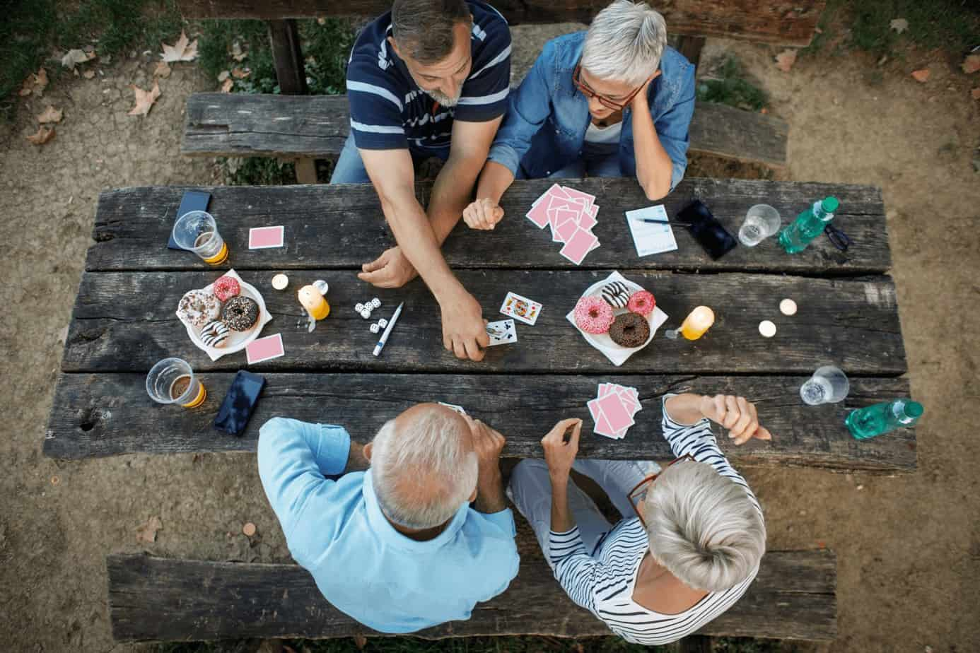 group of senior citizens playing cards