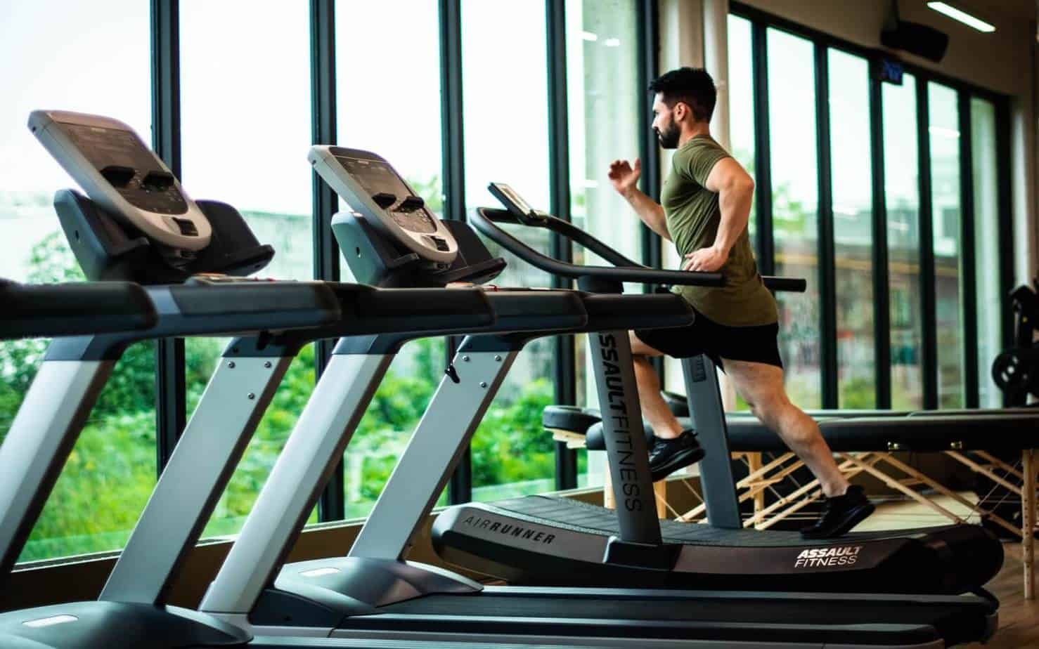 a man using a treadmill as his hiit workout