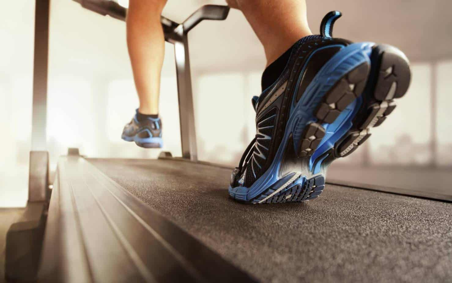 man speed walking on treadmill for HIIT workout in the morning