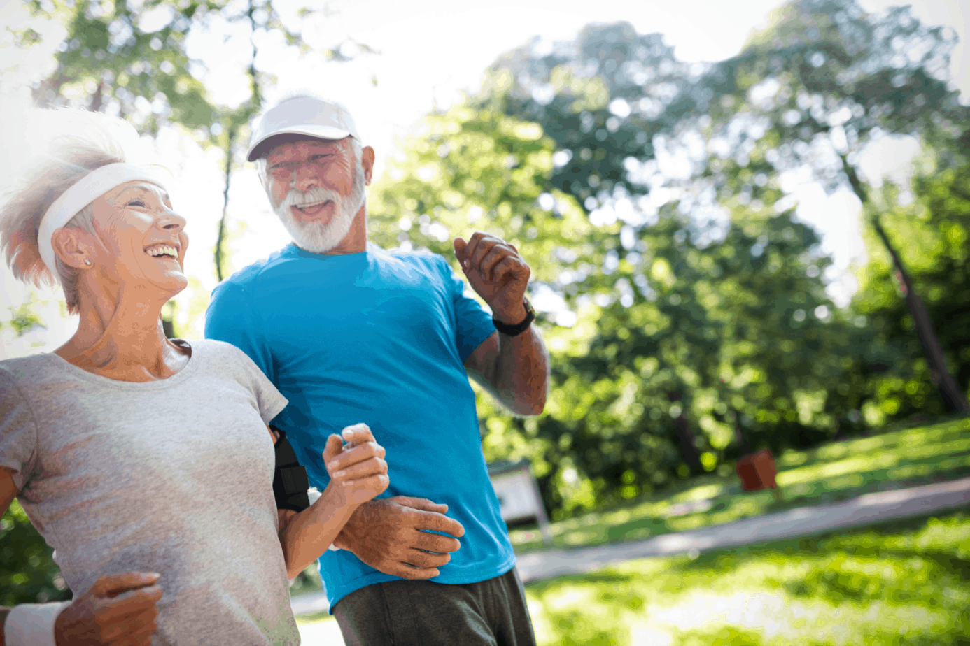 senior couple smiling while running at the park inspired by senior fitness quotes