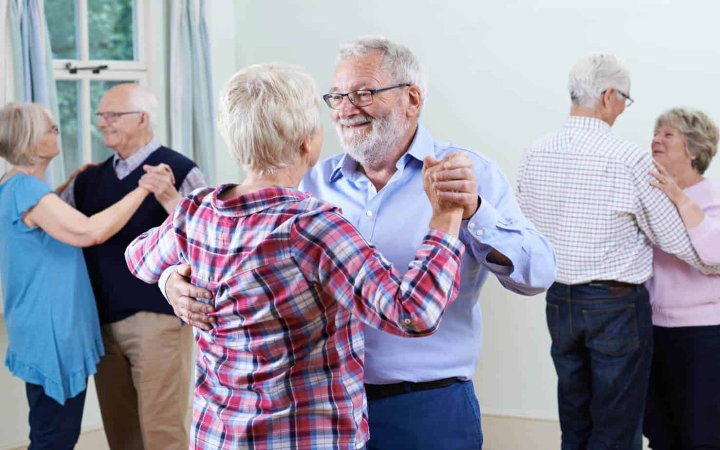 group of seniors dancing while on a speed dating event