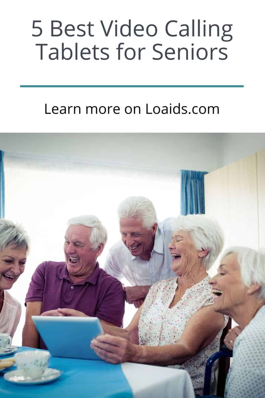 group of senior citizens using a tablet for video calling