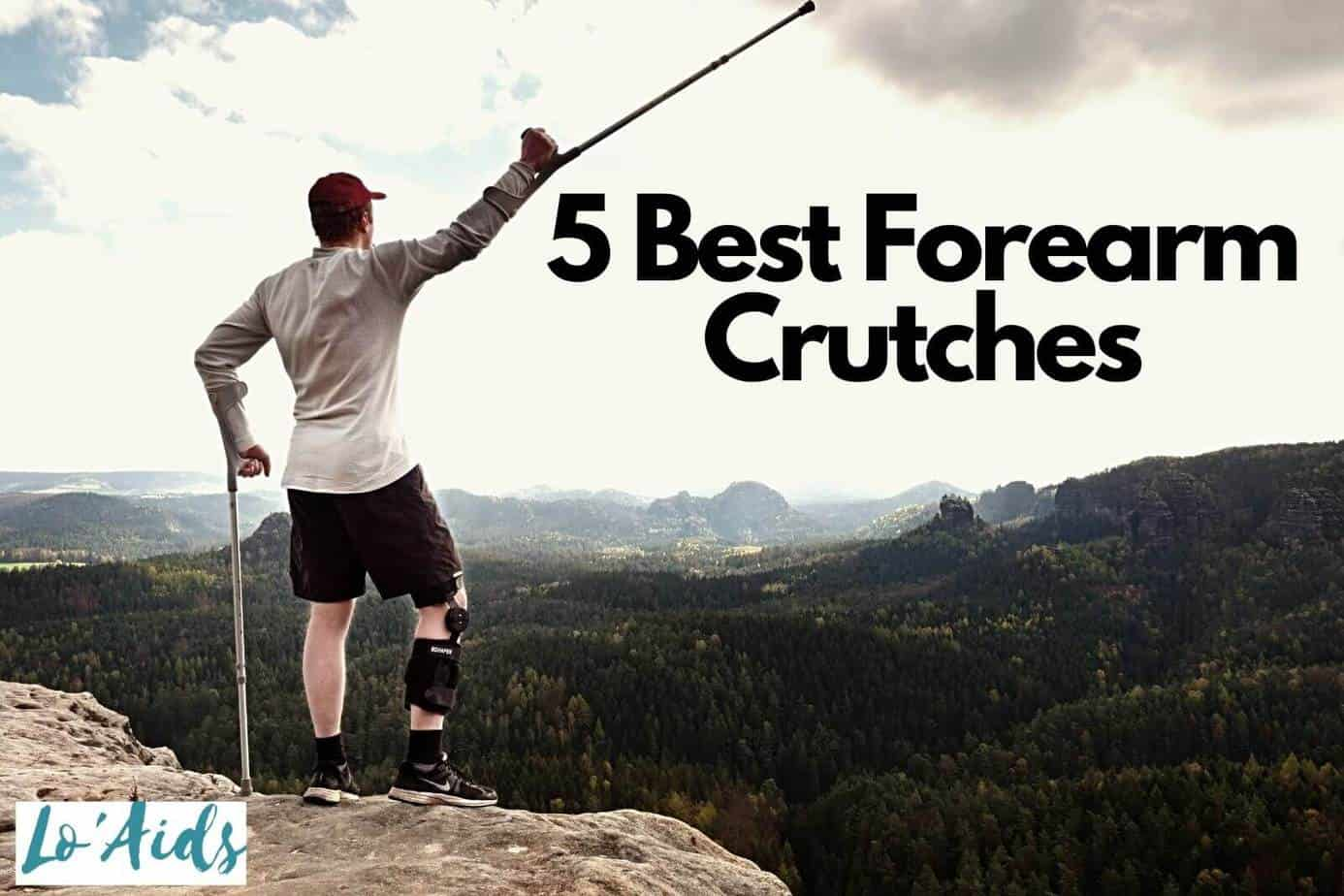 a man on top of a mountain while raising his best forearm crutches
