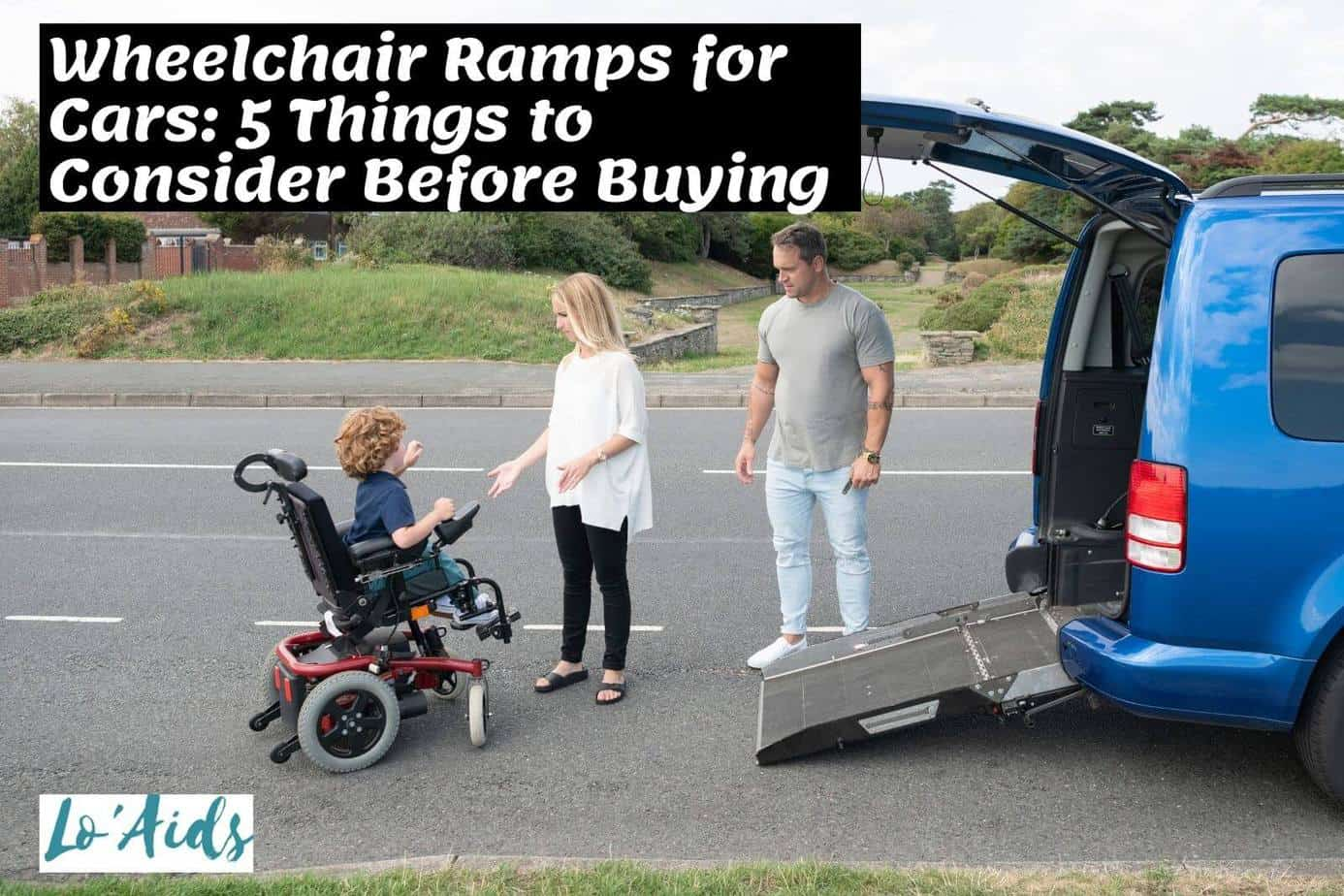 parents helping their kid in a wheelchair while using foldout ramp