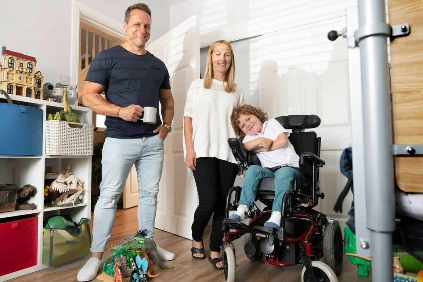 mother and father with his son in a power wheelchair
