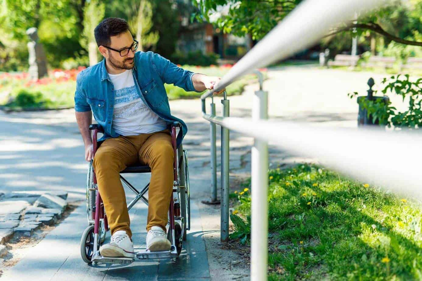 a man using a wheelchair at the park