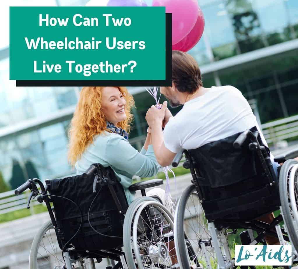 A couple in a wheelchair holding pink balloons. The question is how can two wheelchair users live together?
