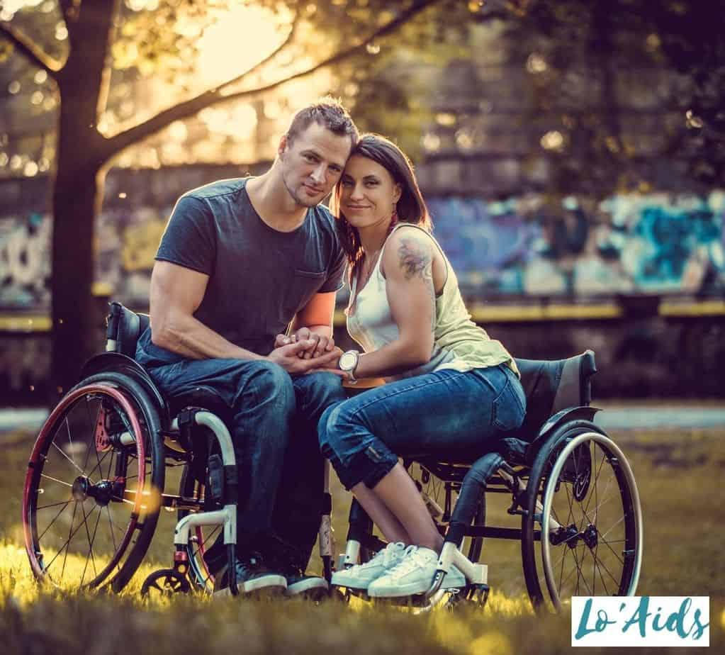 a sweet couple in a wheelchair at the park