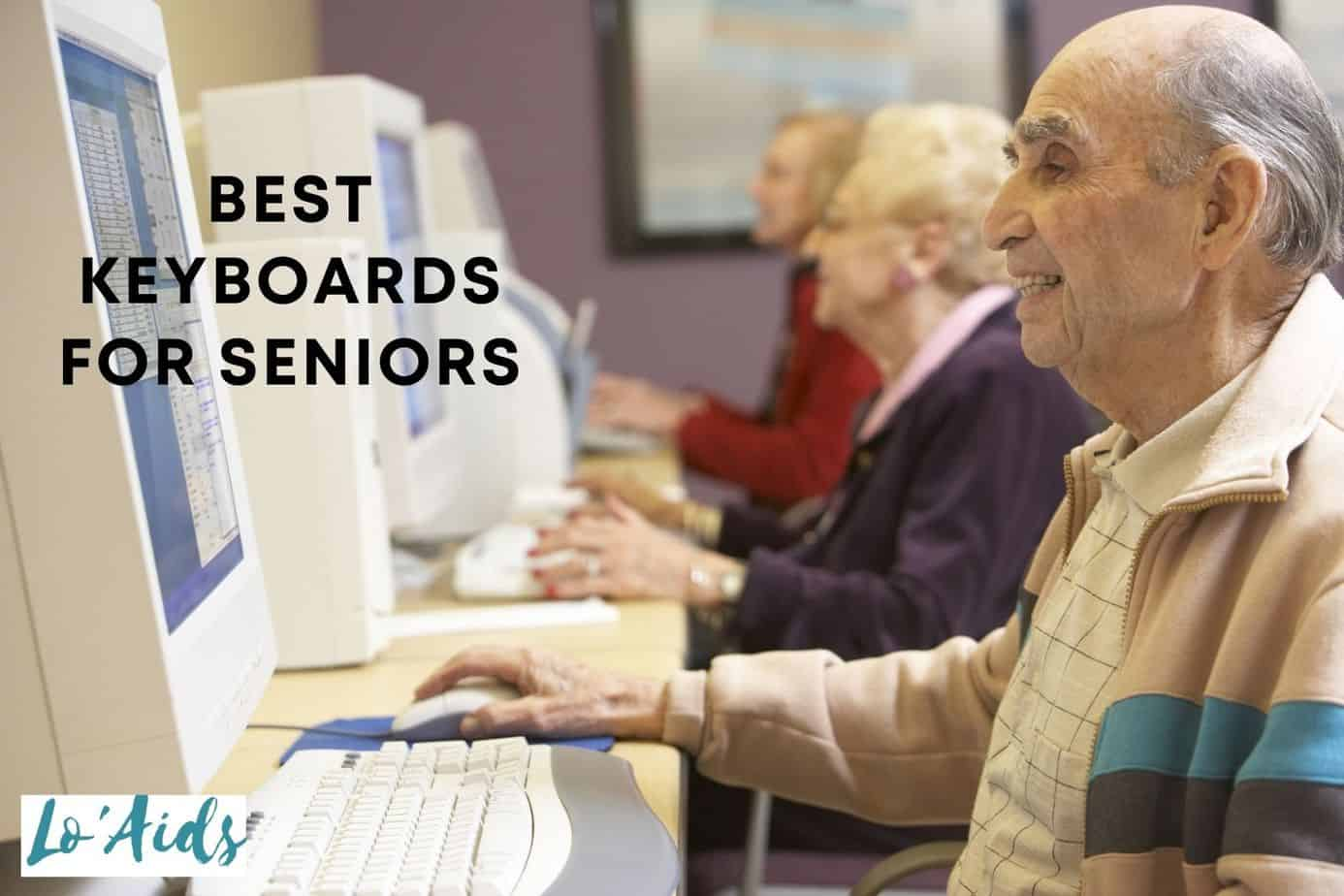 group of older people using a computer with the best keyboards for seniors