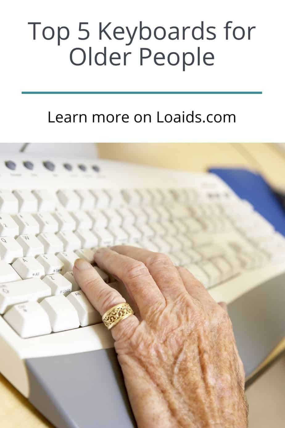 a hand of a senior lady using a white keyboard