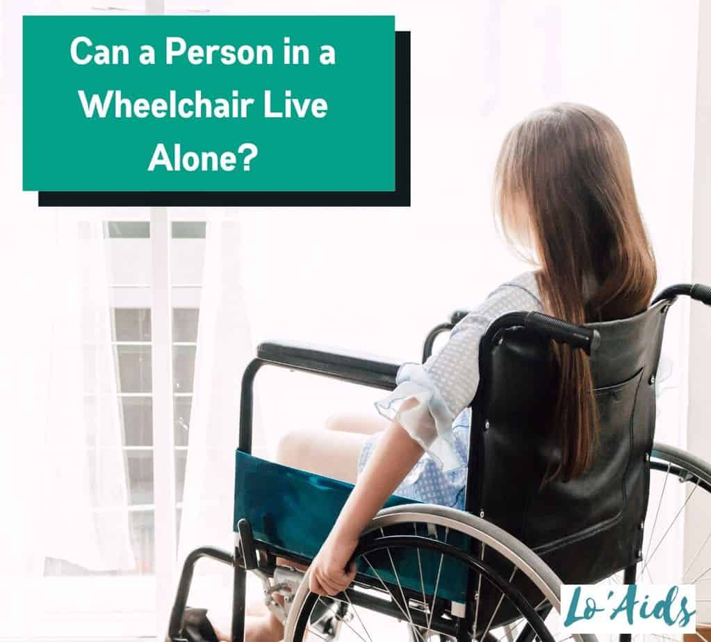 a young lady in a wheelchair is looking outside the condominium