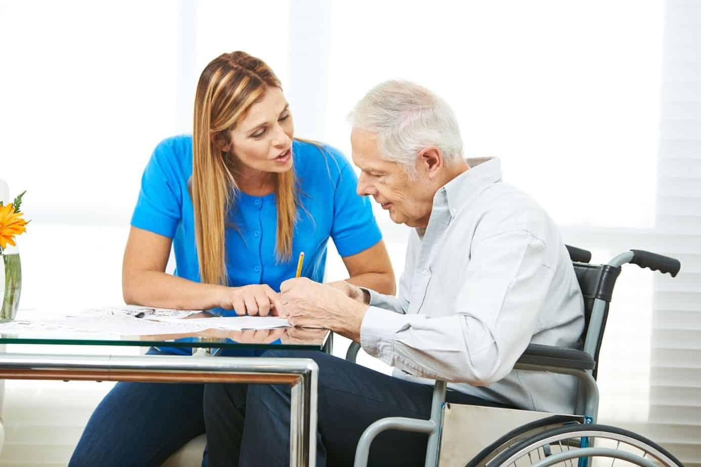 senior man writing an application for a free wheelchair