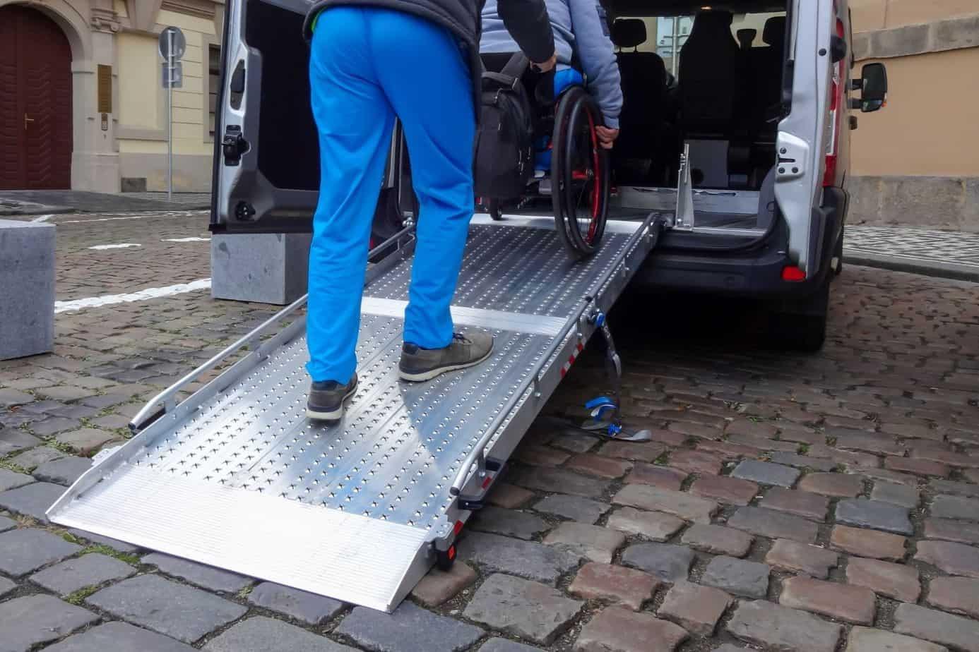 pushing wheelchair inside the van