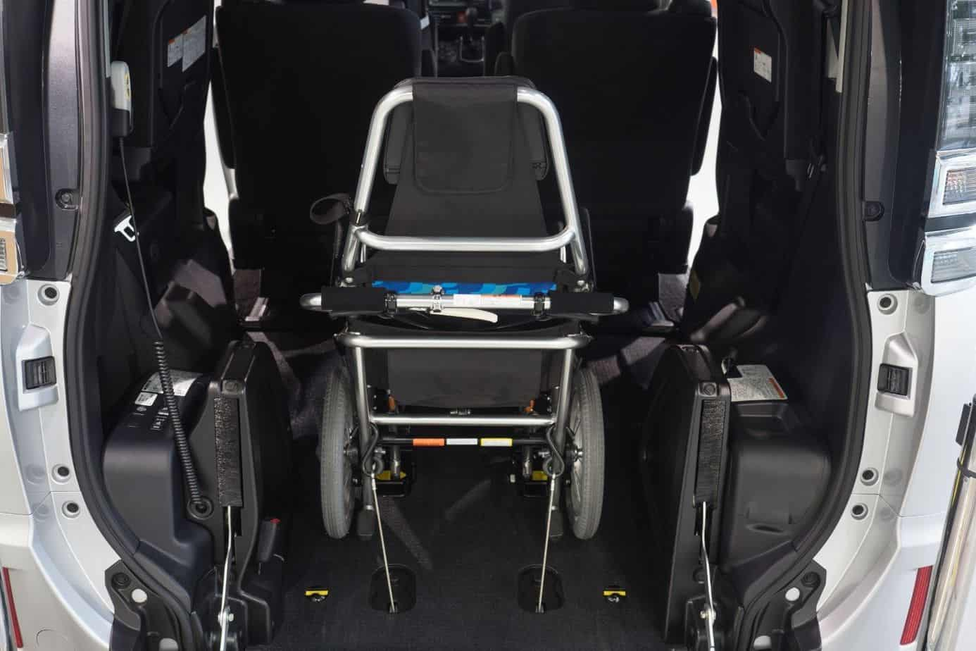 wheelchair stored at the back of the car