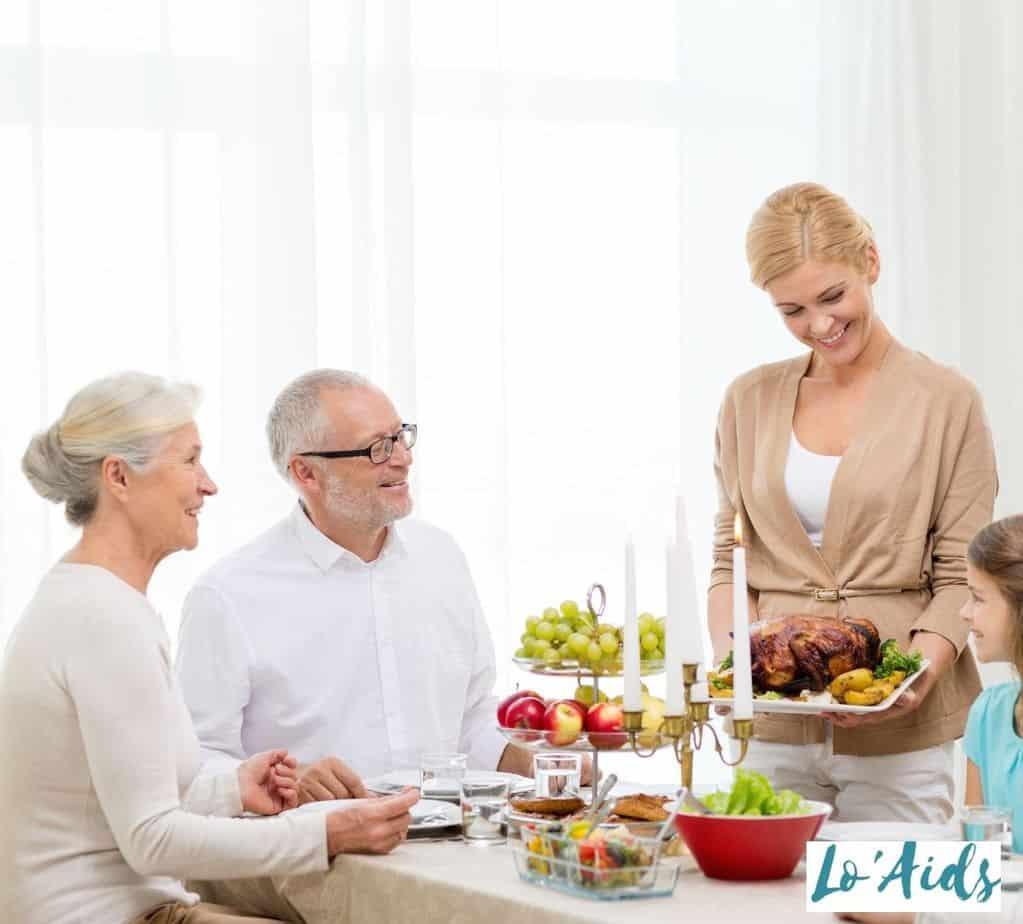 a joyful family having a family dinner for 75th birthday ideas of their father