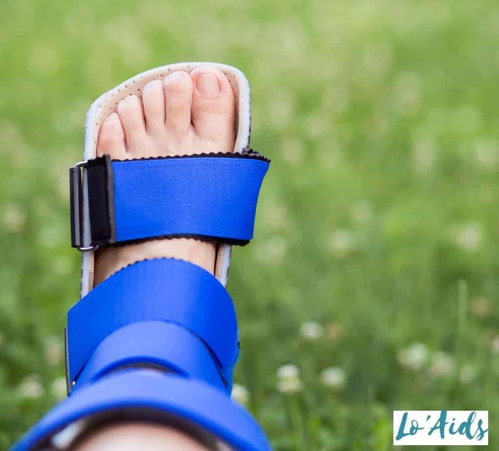 lady's feet wearing a blue AFO brace