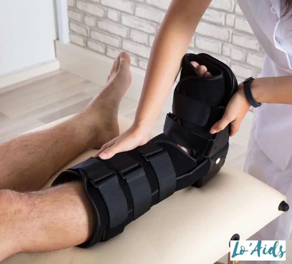 nurse fitting an AFO brace to a man's legs