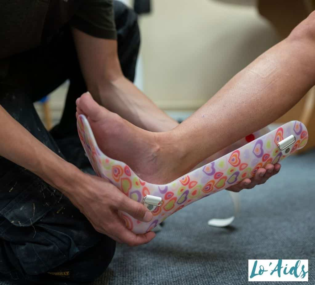 staff showing how to put on an AFO brace correctly
