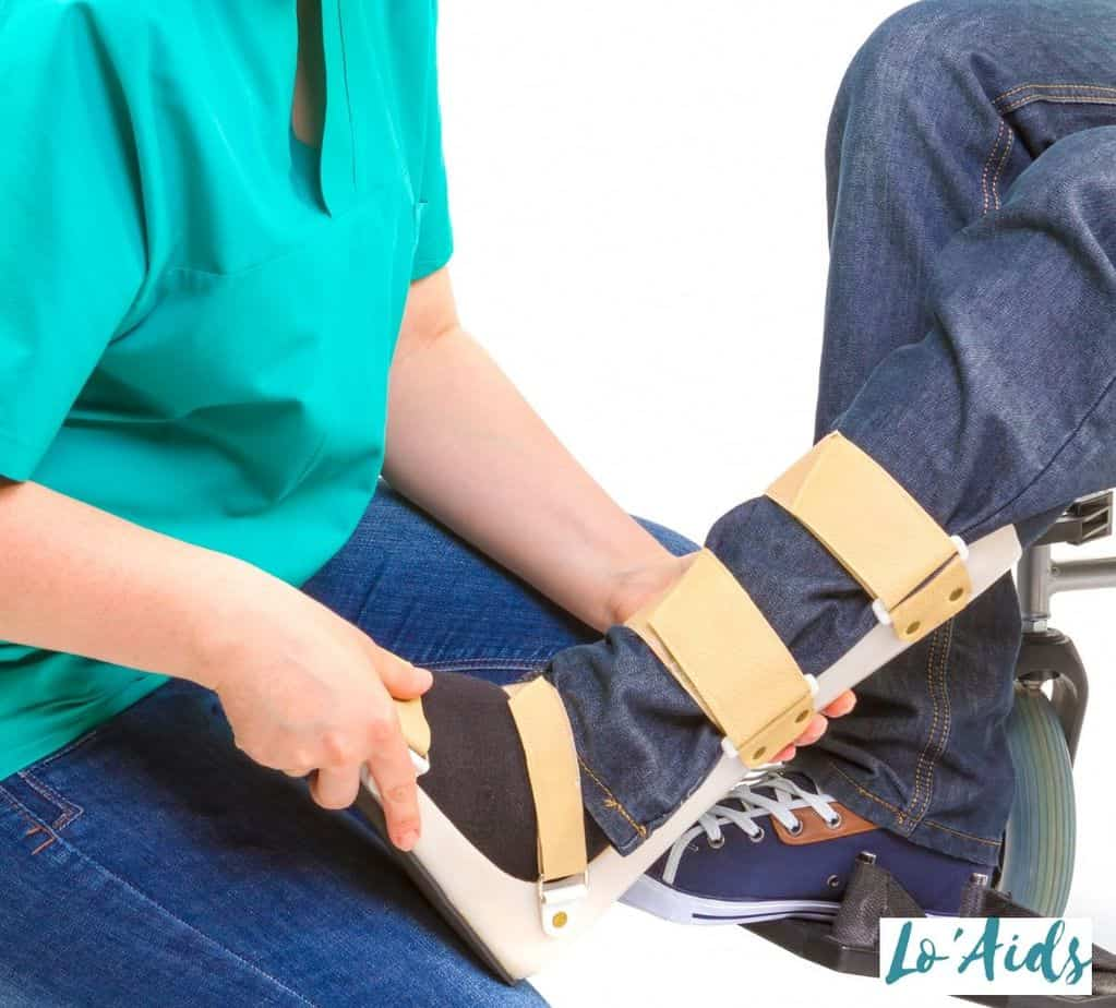a nurse putting on an AFO brace to a patient's feet: How Does an AFO Help Drop Foot?