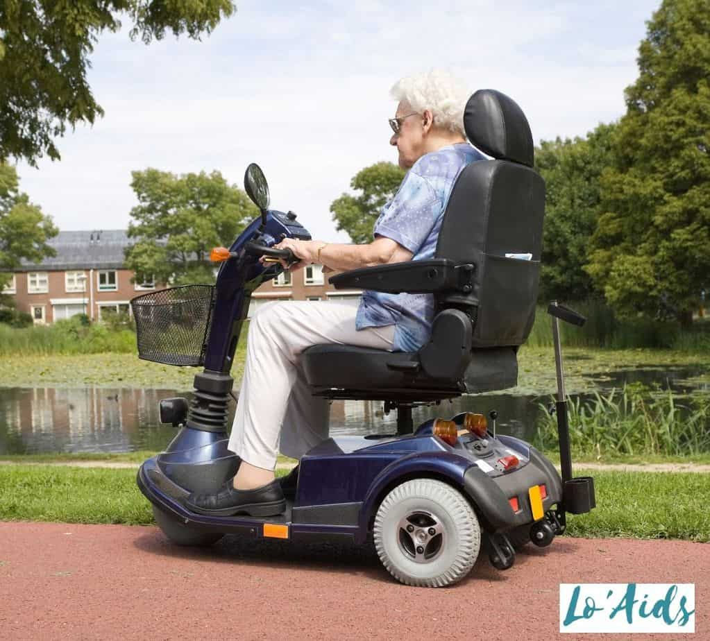 a side view of an elderly woman riding a mobility scooter