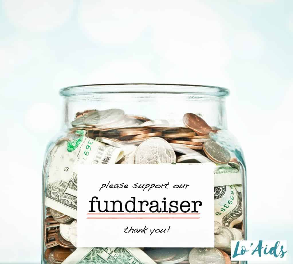 bills and coins inside a fundraiser jar