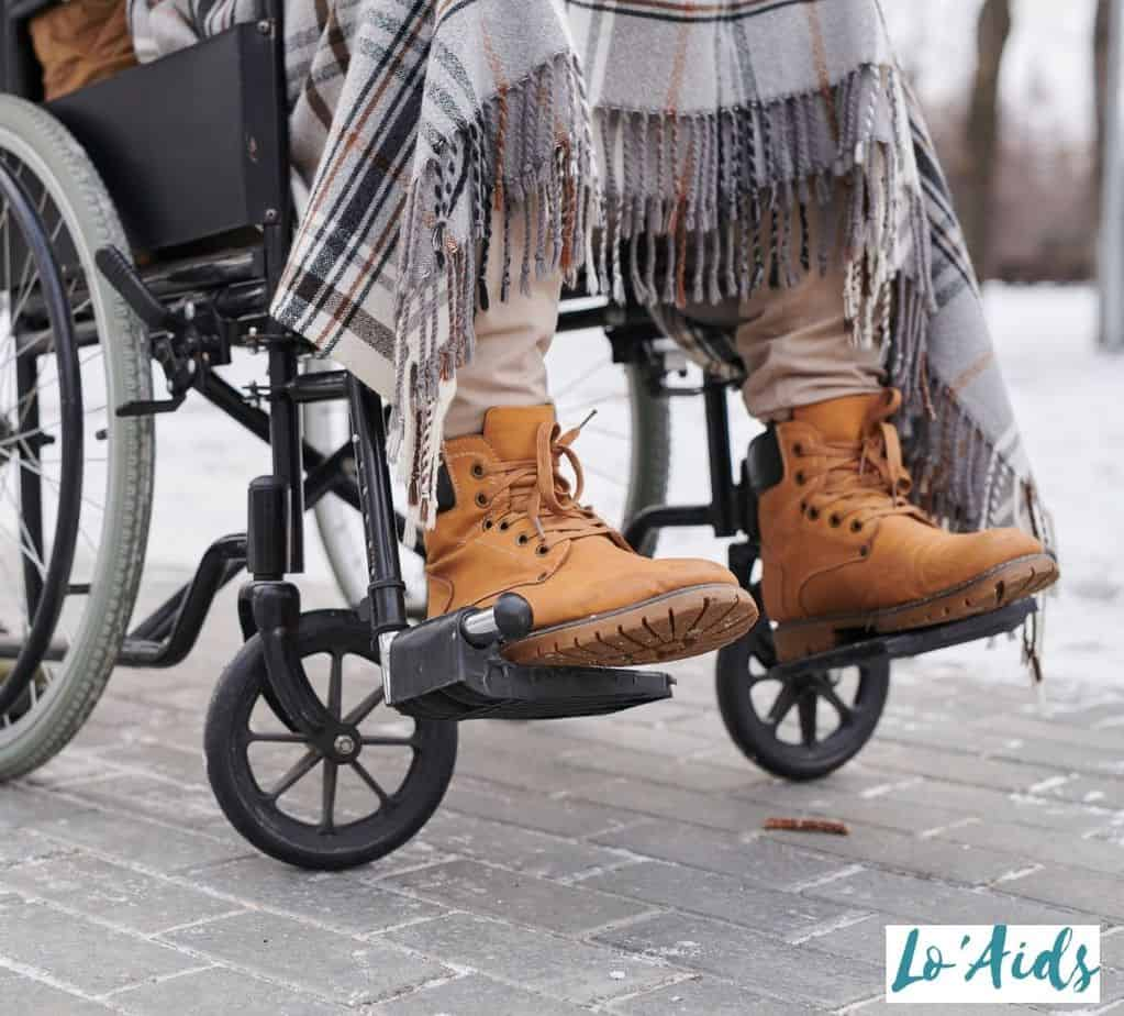 leather shoes of a man in a wheelchair