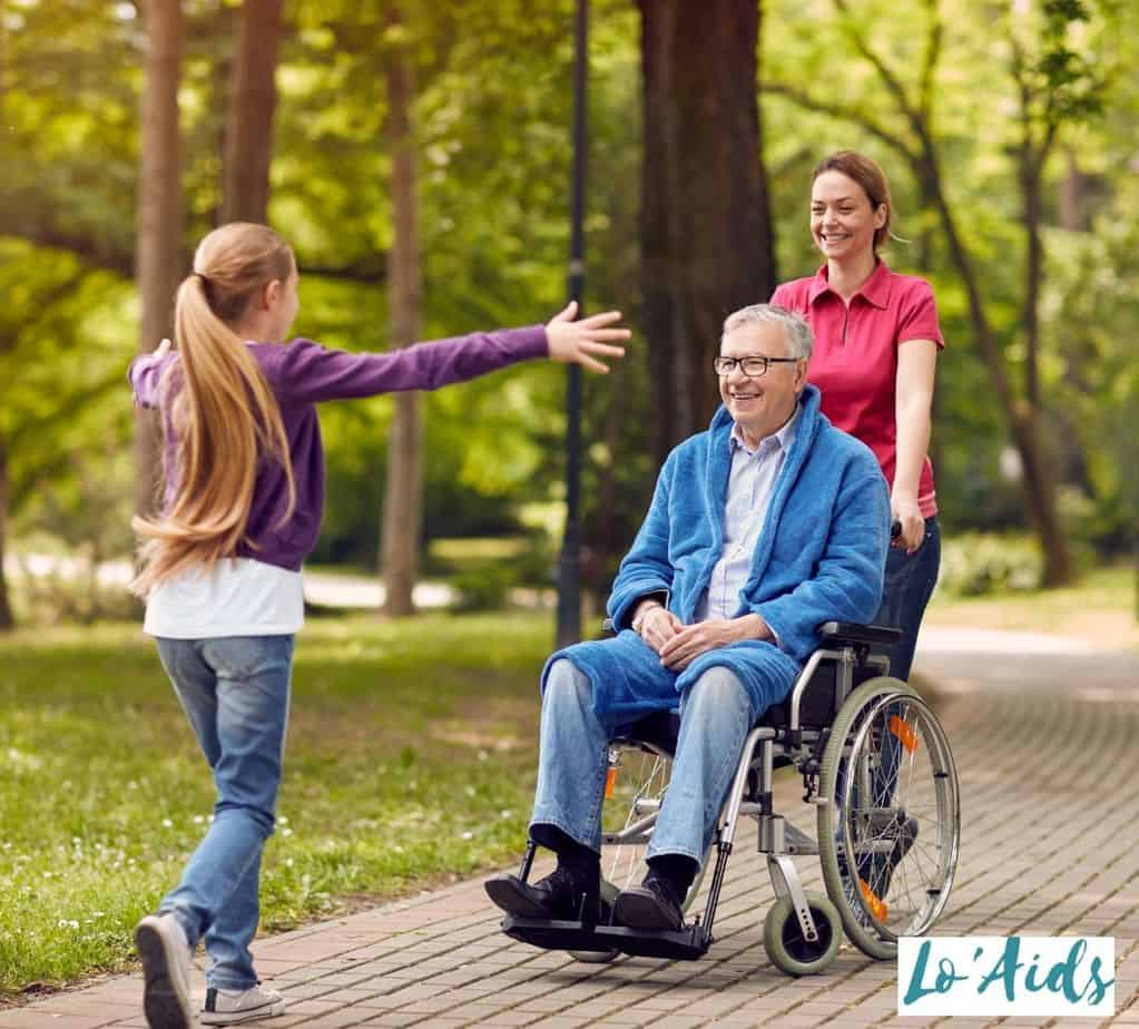 little girl about to embrace her grandpa in wheelchair