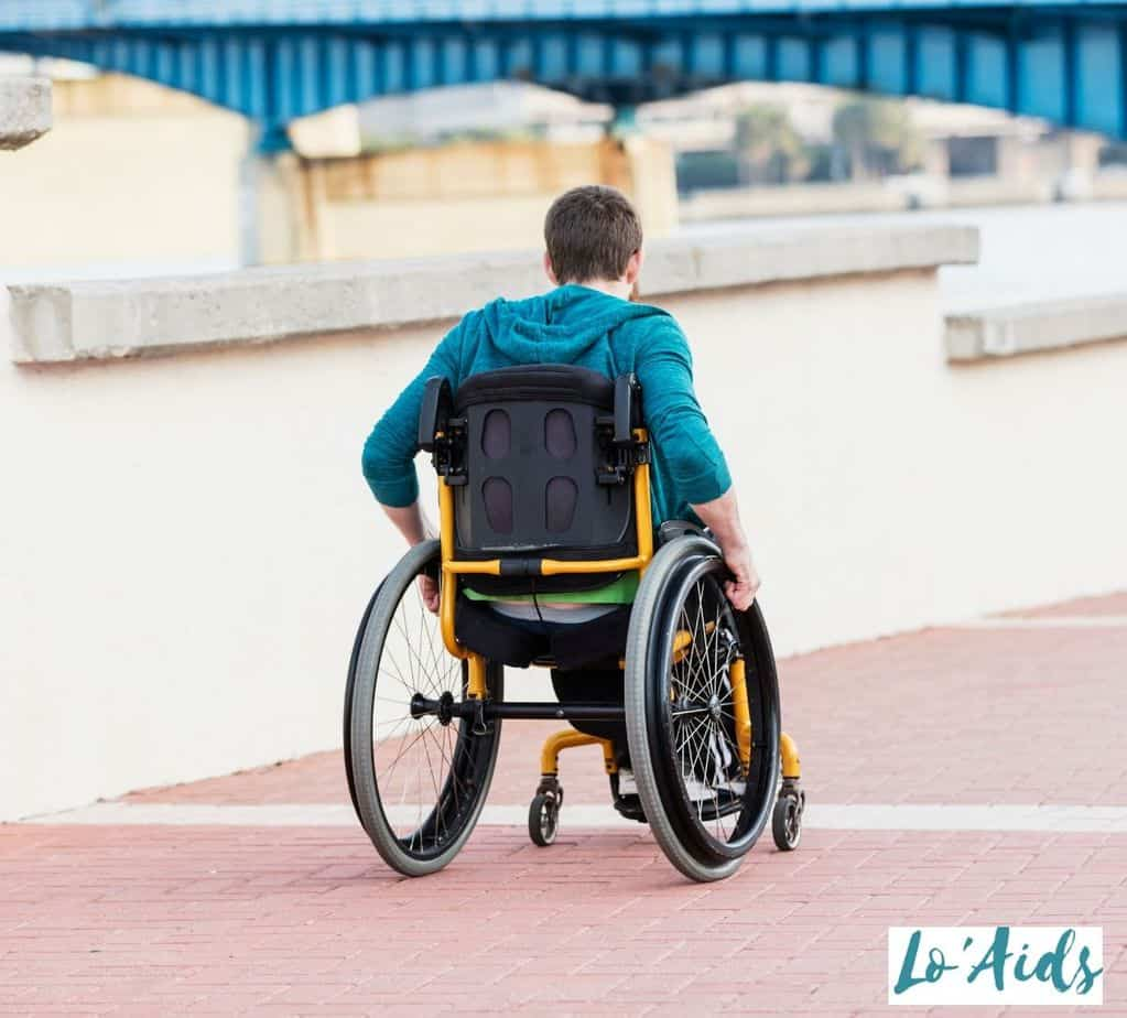 back view of a man propelling his wheelchair