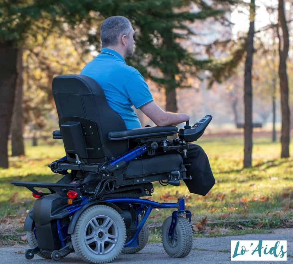 senior disabled man riding an electric wheelchair which is one of the most convenient types of wheelchairs